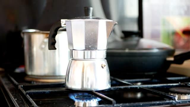 Moka pot coffee maker on a gas cooking hob. video