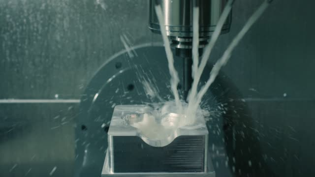 Mold machine drills and sprays water on mold as it's made in manufacturing plant Slow motion shot of mold machine drilling and spraying water on mold as it's made in manufacturing plant molding a shape stock videos & royalty-free footage