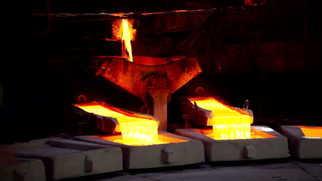 Molten copper Molten copper is poured into molds at Chuquicamata Copper Refinery. (Canon 5DMKII) gold bars stock videos & royalty-free footage