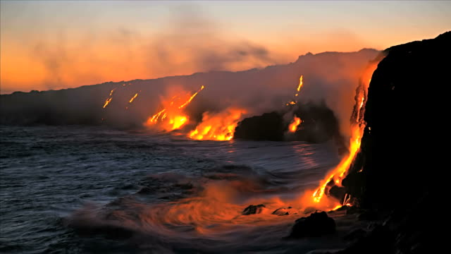 Molten lava pouring into oceans waters at dawn Kilauea Hawaii, Time Lapse video