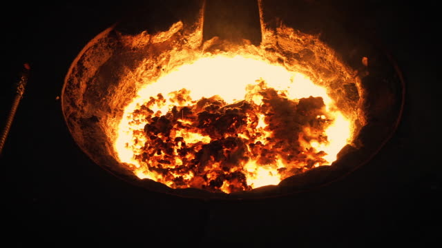 Molten metal melting, operator tapping molten metal from furnace to ladle for pouring to in factory Molten metal melting, operator tapping molten metal from furnace to ladle for pouring to in foundry factory metallurgy stock videos & royalty-free footage