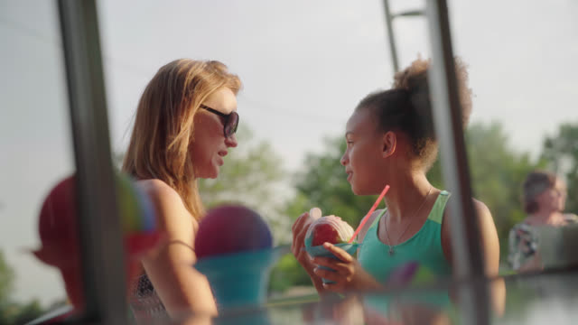 Mom and Daughter Are Served Shave Ice