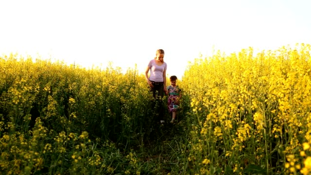 Mom and daughter in a field of flowers video
