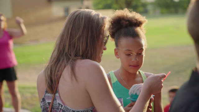 Mom and Daughter Share Snow Cones video