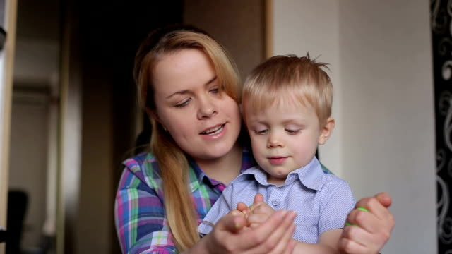 Mom and son are molding plasticine at home. video