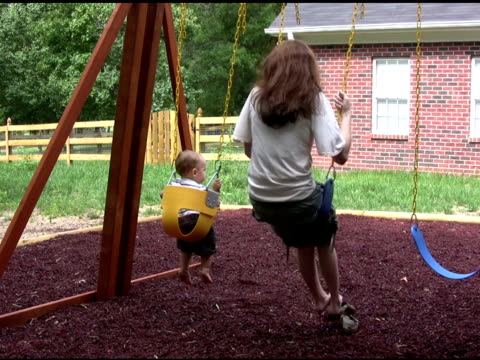 Mom and Son Swing 2 NTSC Mom and Son Swing outdoor play equipment stock videos & royalty-free footage