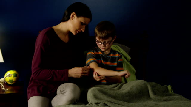 Mom cares for son. video