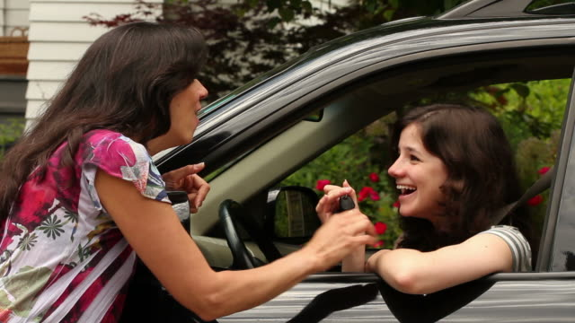 Mom giving teenage girl keys to car video