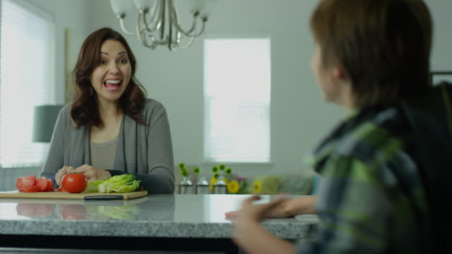 mom in her thirties greets son - один родитель стоковые видео и кадры b-roll