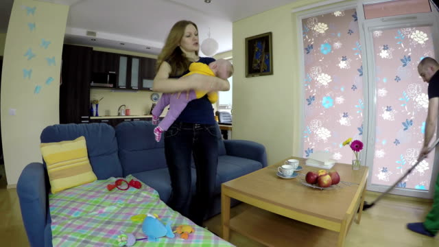 Mom is angry with man that hoover and hinder the baby sleep. video