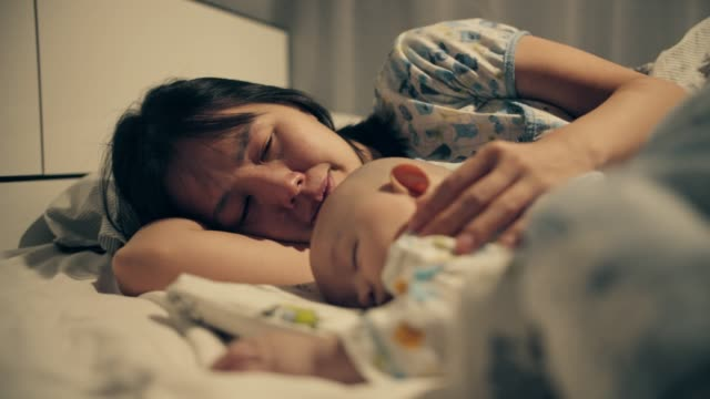 Mom looking her son and crying Asian mother crying and looking her baby son suffering from cancer, family support, 4K Resolution cancer patient stock videos & royalty-free footage