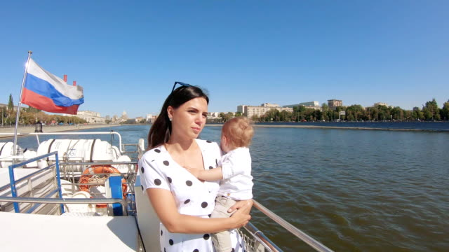Mom with a child on a pleasure boat video