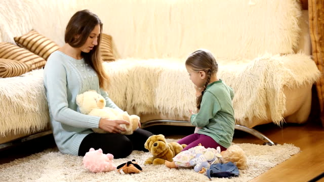 Mom with a child playing with dolls video