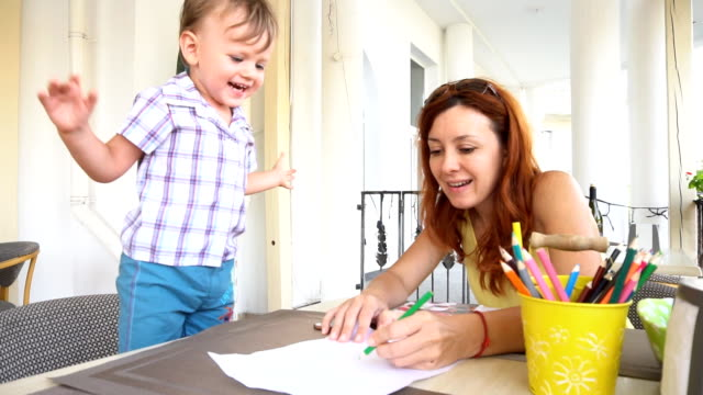mom with son baby painted with colored pencils video