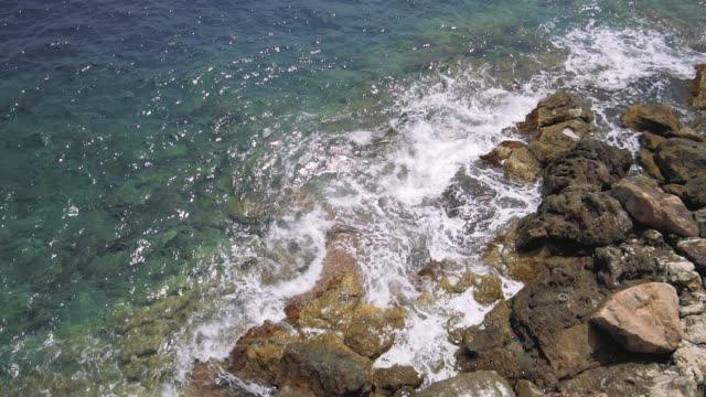 Monaco blue Mediterranean sea waves tide stones in Slowmotion
