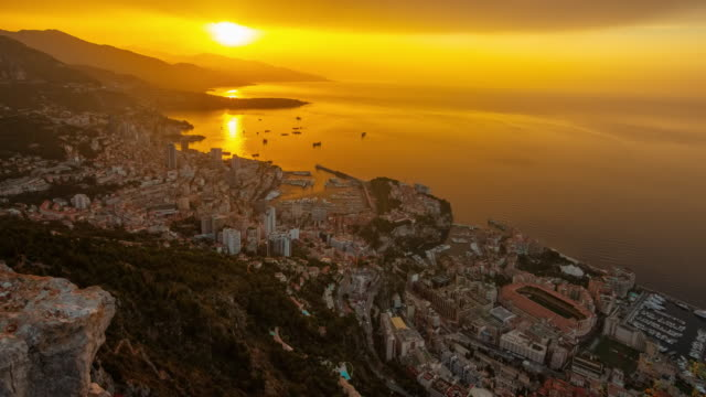 MOTION T/L Monaco City at sunrise Motion control time lapse shot of a beautiful sunrise scene over the Monaco City. Shoot in 8K resolution. monte carlo stock videos & royalty-free footage