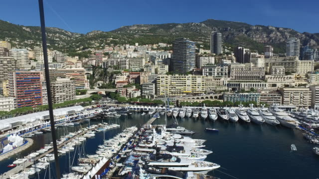 Monaco Yacht Show high view panning High aspect view of Port Hercules, Monte Carlo during the Monaco Yacht Show.  Camera panning from left to right. monte carlo stock videos & royalty-free footage