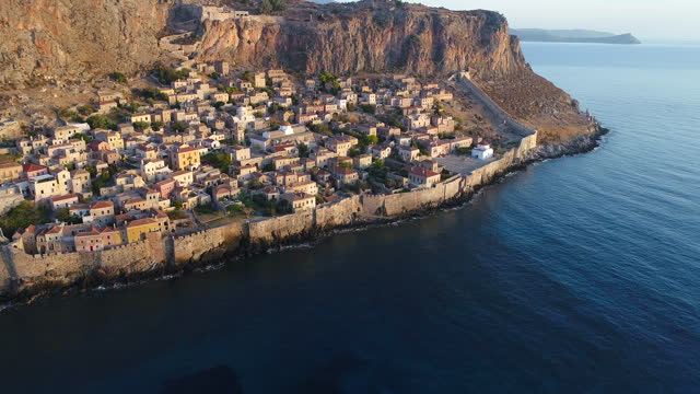 Monemvasia on Peloponnese Amazing Monemvasia, small peninsula on Peloponnese, famous tourist attraction. Footage made with drone at early morning aegean sea stock videos & royalty-free footage