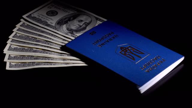 money and passport on the table - dollar bill стоковые видео и кадры b-roll
