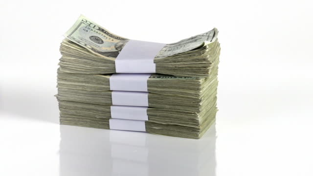 Money Drop A big stack of money is dropped onto a white surface. paper currency stock videos & royalty-free footage