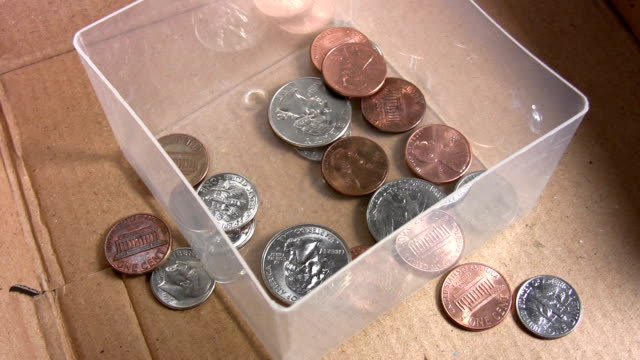 Money falling into a box