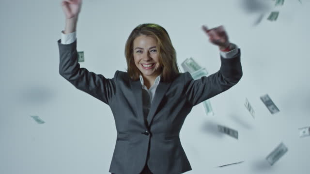 Money Falling on Dancing Businesswoman video