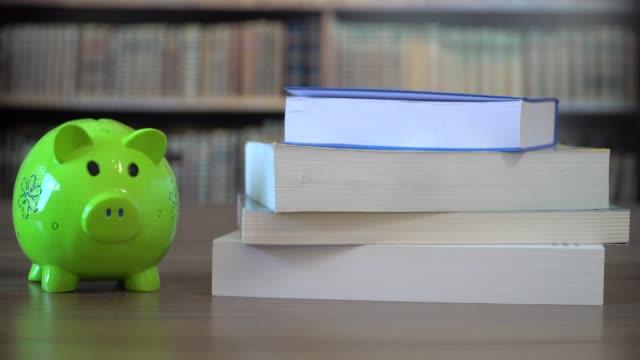 money for school, college funding - salvadanaio video stock e b–roll