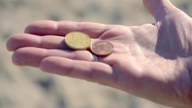 Money in hand Money in hand us coin stock videos & royalty-free footage