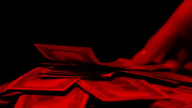 vídeos y material grabado en eventos de stock de dinero en las luces rojas, mano de womans que toma el billete del dólar, concepto de la prostitución - human trafficking