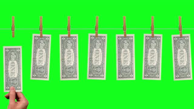 $1 Money line, back side of $1 dollar bills on green screen