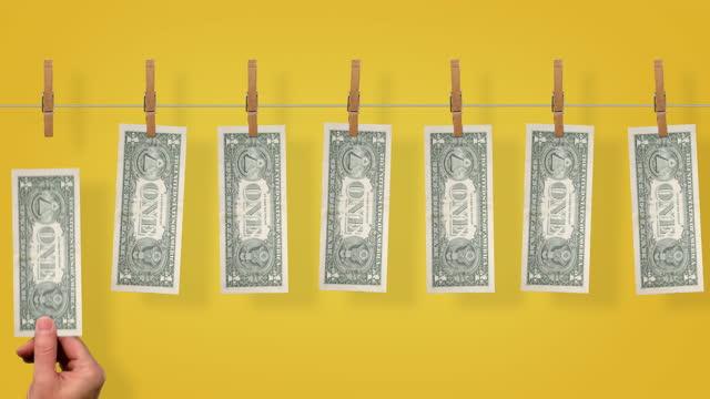 $1 Money line, back side of $1 dollar bills on yellow background