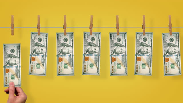 $100 Money line, front side of $100 dollar bills on yellow background