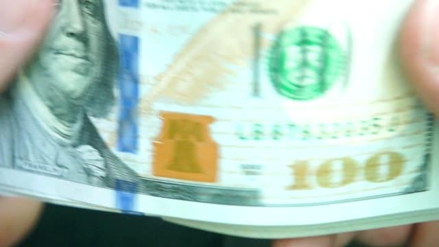 money pack in hands. hundred dollar bills (p. ii) video