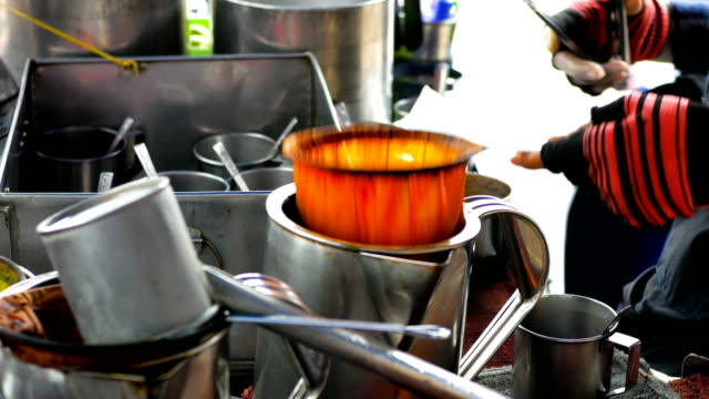Monger making ice coffee on mobile shop, Thai street food video