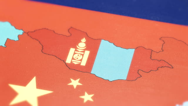 mongolia with national flag on world map - monti urali video stock e b–roll