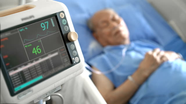 ecg monitor, medical equipment with senior asian patient male in hospital - morte video stock e b–roll