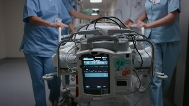 ds monitoring signs of a patient on a gurney going to the or - medical equipment stock videos and b-roll footage