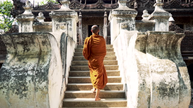 Monk in temple Buddhist monk walking in temple , Myanmar. buddhism stock videos & royalty-free footage