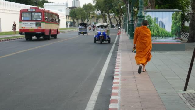 Monk, Tuk tuk and traffic in Bangkok video
