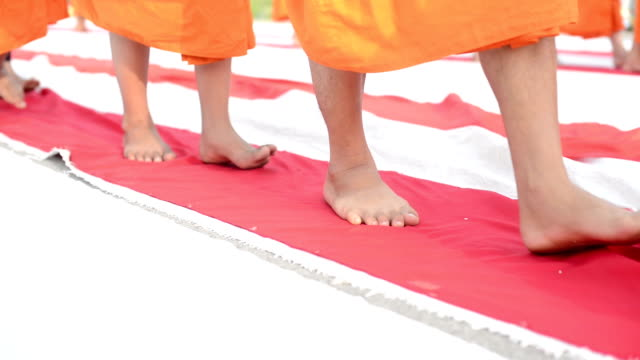 Monk walking on red line video