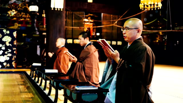 Monks praying in a Japanese temple video