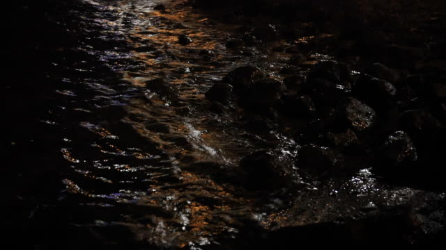 Monochrome, abstract, background, composition of stones submerged in sea water with visible texture