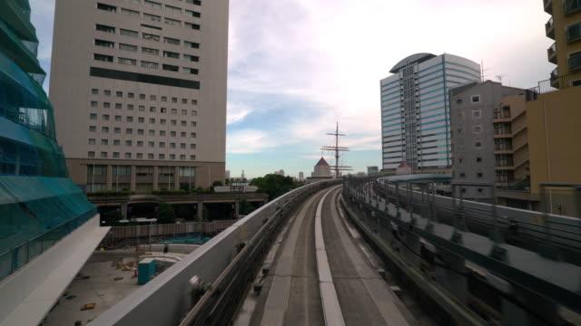 4k uhd monorail riding in tokyo japan - daimon video stock e b–roll