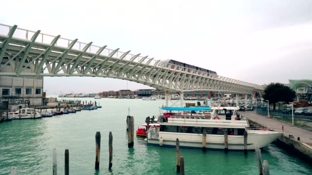 Monorail train in Venice port. Tronchetto island, Piazzale Roma traffic of water taxi with tourist 4K video