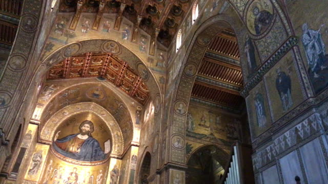 Monreale Cathedral, in Sicily, View of Interior The wonderful cathedral of Monreale was built by the norman WIlliam the II in few year starting in 1174. It is a masterwork of norman-arab culture, known all over the world for the golden mosaic decoration of the interior. mosaic stock videos & royalty-free footage