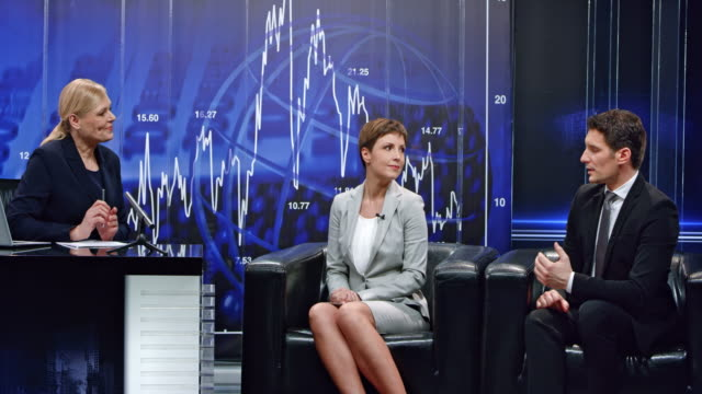 Montage: Female business talk show host leading an interview with two guests in the studio video