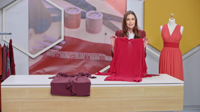 Montage: Female host of a tv show about sewing talking to her audience and presenting the designs