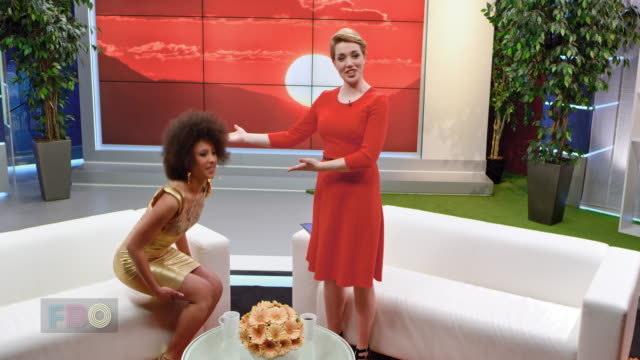 Montage: Female talk show host giving a warm welcome to her female celebrity guest video