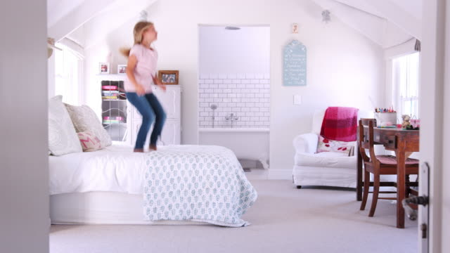 Montage of a young girls activities in her bedroom