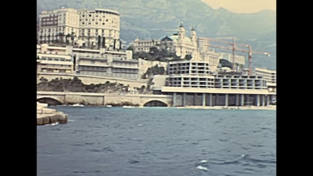 Monte Carlo port Historic restored footage on 1960s of luxury boats and yachts. at the historical port Hercule in Monte Carlo, Monaco,France. In front of the roads of the Grand Prix of Monaco. monte carlo stock videos & royalty-free footage